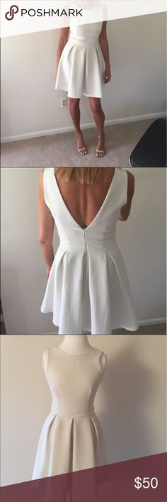 """ASOS:  Skater Dress ASOS:  Ivory/Cream Skater Dress. Sleeveless Dress Length from Shoulder Seam to Hem is approximately 33.5"""";  waist circumference is 26""""; Dips to """"V"""" in the back approximately 11.5 to 12"""" deep; Front neck line is crewneck style.  Darts in front. This dress is fitted in the waist. BRAND NEW!  NEVER WORN!  TAGS ATTACHED! ASOS Dresses Mini"""