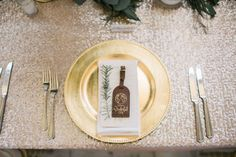 Gold accent plates and a party favor is the perfect way to set a table! Captured by Jessica Gold Photography #bridesofnorthtx #wedding #placesetting