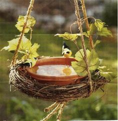 Grapevine birdbath.  I think I might make this and hang in my front yard.  I could use it for water in the summer and feed in the winter.  Great idea!