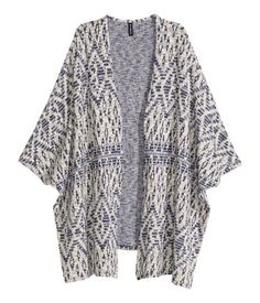 Wide-cut, pattern-knit cardigan with 3/4-length sleeves and no buttons.