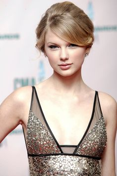For the 42nd Annual CMA Awards Swift goes for a bouffant-inspired updo.   - HarpersBAZAAR.com
