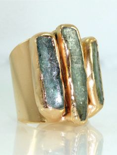 beautiful green and gold cocktail ring