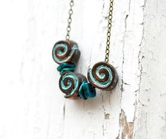 Spiral Necklace rustic patina shell beads on by MayaHoneyJewelry