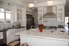 The design firm Gary M. Lane knows that white subway tile is a smart choice for a remodel of an older house. The look of these classic ceramics isn't tied to a particular period, so they look like they could have been there from the house's beginning.