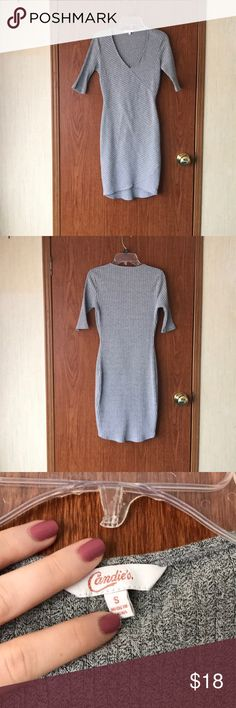 Textured Bodycon Dress Gray Textured Bodycon Mini Dress Size S Worn twice, no flaws! V-neck.  Kind of has a petal pattern where the material meets, the front hem is about an inch higher than the back hem.  Length: 33 in  Please ask any questions! Offers welcome! All bundles come with an extra discount! Candie's Dresses