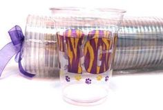 """LSU Tigers disposable clear cups printed with """"TIGERS"""" all the way around the cup in purple and gold tiger stripes."""