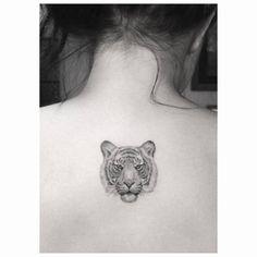 celebritattoo:  Ariel Winter | Fine line style tiger head tattoo...