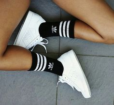 Adidas sporty look. The three white stripes on black socks with white logo. And…