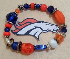 NFL Broncos Bling!  Ladies, Get Your Game (Bling) ON!  Stretch Bracelet in Bronco Colors.  Beads of Glass, Ceramic, Crystal & Metal by SerendipitysRarities on Etsy