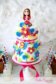 Quilling cake! I like the flowers on the side, maybe for a little girls birthday?