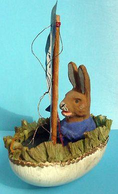 Lovely rabbit in egg boat