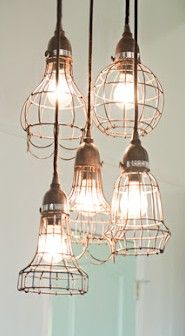 I am simply 'hung up' on these 'light cluster' chandeliers..  unique idea ✓