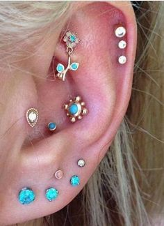 Cute Multiple Ear Piercings in Blue Opal at MyBodiArt