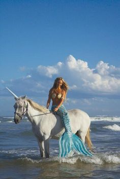 Mermaid and unicorn on the beach