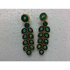 Shop Lovely Green Party Wear Paper Quilled Jumka Earrings by Eniya Elegance online. Largest collection of Latest Earrings online. ✻ 100% Genuine Products ✻ Easy Returns ✻ Timely Delivery