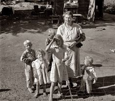 August 1939. Yakima Valley, Washington. Shacktown community, mostly families from Kansas and Missouri. This family has five children, oldest in third grade. Rent 7 dollars per month, no plumbing. Husband earns 44 dollars per month. According to the CPI Inflation Calculator, this husband was making the equivalent of 729 dollars in 2012 dollars which wasn't much for a big family. Still, I see unity in family, mostly clean clothing, and most of all smiles and the normal mischief looks of…