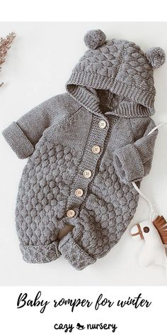 Baby Romper : Adorable knitted baby jumpsuit with chunky knit design, comfortable hood and cute pom pom ears. Knitted from a soft cotton blend material. Knitted Baby Outfits, Knitted Baby Clothes, Knitted Romper, Baby Knits, Knit Baby Sweaters, Baby Boy Knitting Patterns, Knitting Designs, Baby Romper Pattern, Baby Overall