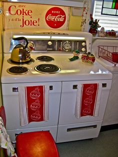 love the stove - the simple Christmas teatowels make it look festive