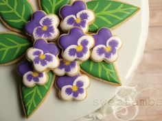 If you're looking for something sweet and pretty for a special occasion (Mother's Day brunch, perhaps?), then you've come to the right place! These pansy cookies are pretty simple to make, so no big deal if you've waited until the last minute. If you