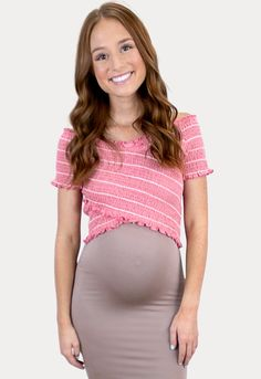 Pink Striped Maternity Crop - Sexy Mama Maternity Stay on trend with this crop top! Our pink striped maternity crop top is a must have top for every Mama's wardrobe. This smocked crop top pairs perfectly with one of our Over the Belly Skirts. Constructed with stretchy form fitting material it's perfect to wear throughout all nine months of pregnancy and beyond! #SexyMamaMaternity #maternityclothes #maternitywardrobe #bumpstyle Maternity Crop Tops, Cute Maternity Dresses, Pregnancy Wardrobe, Pregnancy Outfits, Pregnancy Months, Bump Style, Casual Tops, Stylish, Sexy