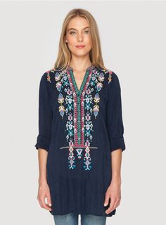 Azten Blouse The Johnny Was AZTEN BLOUSE is a bohemian must-have! This tunic top features colorful Aztec-inspired embroidery designs along the front and back. Layer this embroidered tunic over a silk slip to wear it as a mini dress, or style it with skinny jeans and boots!  - Rayon Georgette - Six Button Henley Front, Long Sleeves - Signature Embroidery - Care Instructions: Machine Wash Cold, Tumble Dry Low
