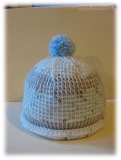 Just use any knit in the round hat pattern and follow instructions using the Tunisian crochet stitch instead of knit stitches.  Very easy to transform any knit pattern into Tunisian crochet items.