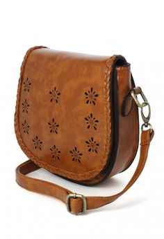 - Craft from leather look fabric - Braid trimmed rim on front flap- Floral cut out detail on front flap- Removable adjustable strap- 100% Polyurethane- Wipe with cloth Length / Width / Height 20 * 7 * 18 (cm) 7.5 * 2.5* 7 (inch)