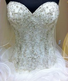 Bridal gown found at Mimi's Bridal in Laurel, Mississippi.  It has the most flattering Swarovski crystals.   It is breathtaking!