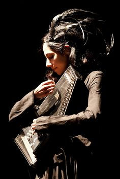PJ Harvey (born 9 October 1969) is an English musician, singer-songwriter, composer and occasional artist. Primarily known as a vocalist and guitarist, she is also proficient with a wide range of instruments including piano, organ, bass, saxophone, harmonica, and most recently, the autoharp.