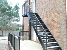 Steel stairs with a powder coated finish. Chequer plate treads and round tube balustrade.