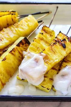 Pineapple with Coconut Rum Sauce. Sweet, juicy, caramelized grilled pineapple drizzled with a creamy coconut rum sauce.Grilled Pineapple with Coconut Rum Sauce. Sweet, juicy, caramelized grilled pineapple drizzled with a creamy coconut rum sauce. Fruit Recipes, Appetizer Recipes, Cooking Recipes, Doce Light, Grilled Fruit, Grilled Pineapple Recipe, Grilled Desserts, Pineapple Recipes, Grilled Okra