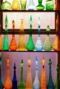 Retro glass bottles at Upcycled home and garden Oceanside ca. Antique Bottles, Vintage Bottles, Antique Glass, Bottles And Jars, Glass Bottles, I Dream Of Genie, Blenko Glass, Genie Bottle, Bottle Display