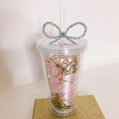make giving a coffee gift card fun. Fill a reusable cup with ribbon, tinsel, and put the gift card inside. (by Ashley G)