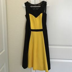 """Black & Yellow Lace-Yoke Fit & Flare Dress. Color block styling brings figure-defining detail to this brilliant fit-and-flare styled with a flouncy hem and splashed with romantic lace along the yoke.  39"""" long from high of shoulder to hem.  96% polyester / 4% spandex, hand wash. Ile New York Dresses"""