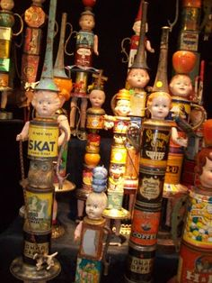 RECYCLE VINTAGE CANS AND DOLL HEAD PARTS INTO ART