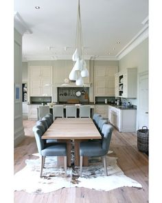 Fresh, fun light fixture.  Love that the dining table is integrated into the kitchen space.