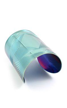 Joomi Lim, titanium cuff