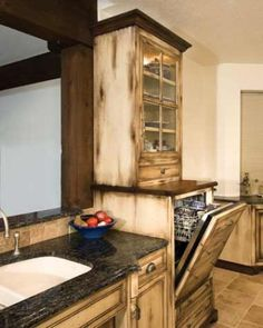 Another view of Country style custom kitchen cabinetry created by Craig Sowers.