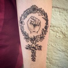 Floral feminist tattoo... Maybe add a men's symbol on it to symbolize genuine equality. +28 more ideas