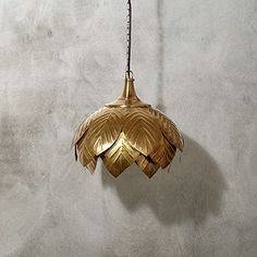 Handcrafted of brass by skilled artisans, the Jasmine Ceiling Pendant is detailed with a decorative leaf pattern for a classic look.