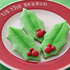Holly Leaf Christmas Cookies...start with a green colored cookie dough, glaze cookies after they are baked and sprinkle with green sugar for the effect shown in the photo