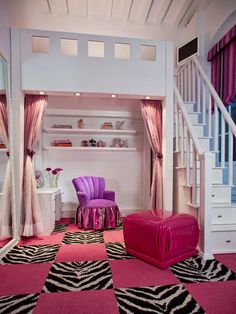 The steps to the bed are drawers that hold toys and other items, and the space underneath the bed is an ideal spot for homework or play. Ambient lighting and pink velvet draperies add softness to the space. Design by JKC Designs