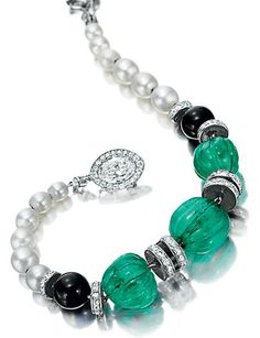 AN ART DECO EMERALD, DIAMOND AND NATURAL PEARL BRACELET, BY CARTIER