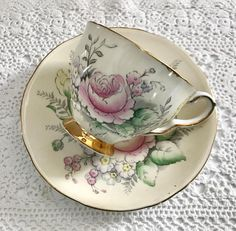 Vintage Royal Stafford china tea cup and saucer, made in England. This duo is beautiful, a fawn ground with hand painted floral details on both the cup and saucer. It is in good condition, no chips, cracks or crazing and both pieces ring nicely. Please Note: The items I sell are