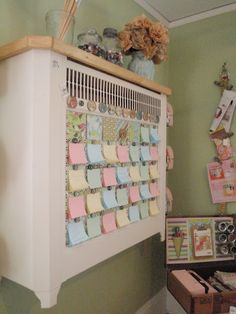 Magnetic Calendar (old radiator cover) with a post-it pad attached for each day - just move the dates at the start of each new month - clever idea! (note: scraproom photos are more than half way down the post)