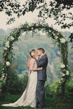 round wedding arch with hanging votive candles