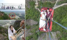 Bride and groom dangle on glass-bottomed bridge in Shiniuzhai National Park