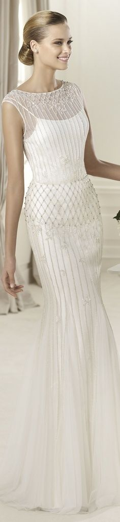 "I think this gown is on the ""plainer"" side - but it's elegant - just my opinion."