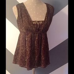 Adorable Michael Kors silky top Such a cute silky Michael Kors top! This looks fantastic paired with jeans, or equally great with a nice pair of slacks. Throw on a cute sweater for cooler evenings, or when it's warm wear without. Michael Kors Tops Blouses