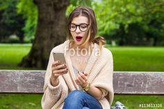 Surprised student girl reading good news